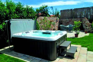 Outdoor hot tub installation with a cover.