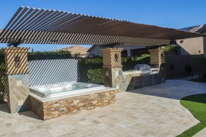 Sundance Spas hot tub installed under a pergola.