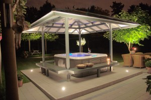 Outdoor backyard hot tub installation in the summer.