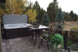 Outdoor Sundance Spas hot tub on a patio.