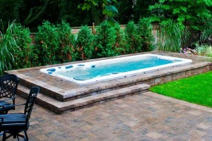 Outdoor in-ground swim spa installation.