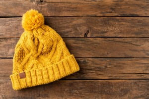 Mustard coloured winter hat.